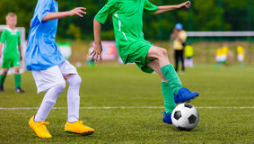 Football soccer game of youth teams. Running young players kicki Stock Photo