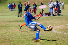 Football Soccer Girl Boot Ball. Girl player striking ball on the her boot at goals during Football soccer match at schools  six a side tournament in Durban Stock Image