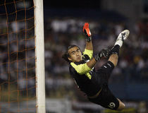 Football Soccer Goal Keeper. TERENGGANU - JANUARY 30: Kuala Lumpur goal keeper Remezey Che Ros attempts a save during their Malaysian Super League match against royalty free stock photo