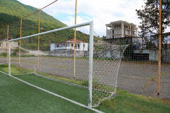 Football soccer goal. With the net at the stadium in the mountains Royalty Free Stock Photo