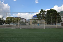 Football soccer goal. With the net at the stadium in the mountains Stock Photos