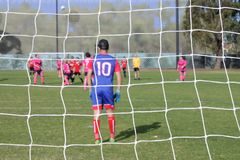 Football Soccer Goal Post Net. Background against unrecognizable soccer players in outdoor public football field on weekend day stock photos
