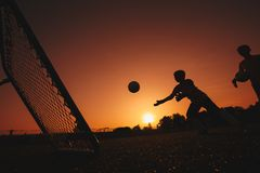 Football Soccer Goalkeeper Training Session. Two Young Goalies Practising in a Field royalty free stock photography