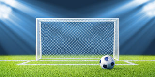 Football (soccer) goals and ball on clean empty gr Stock Photos