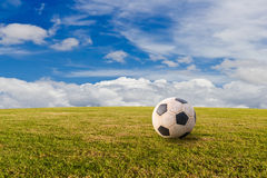 Football ( soccer ) on green lawn Stock Images