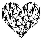 Football soccer heart. Soccer heart concept of lots of football or soccer players in the shape of a heart Stock Photo