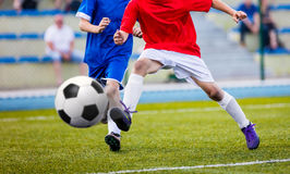 Football Soccer Kick. Boys Kicking Soccer Ball on the Pitch. Soccer football match Royalty Free Stock Image