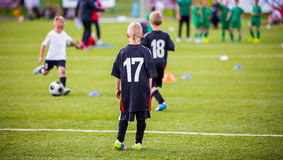 Football soccer match for children. kids playing soccer game royalty free stock photos