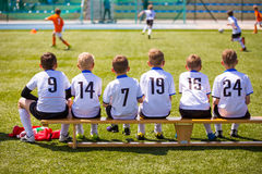 Football soccer match for children. Kids waiting on a bench Stock Photography