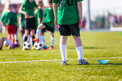 Football soccer match. Training and game for children. Soccer tr. Football soccer training for children. Young boys preparing to the final game of soccer Royalty Free Stock Photo