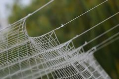Football or soccer net background, view from behind the goal with blurred stadium and field pitch. royalty free stock photos