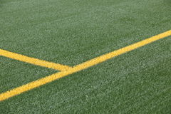Football or soccer pitch. Orange halfway line marking on grass football or soccer pitch Royalty Free Stock Photos