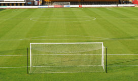 Football or soccer pitch. Scenic view of empty football or soccer pitch viewed from behind goal Royalty Free Stock Photos