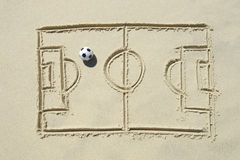 Football Soccer Pitch Line Drawing in Sand. Simple line drawing of football pitch with soccer ball in sand on Brazilian beach Royalty Free Stock Photo