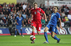 Football Soccer Player. Simon Church (Reading FC) of Wales (left) makes a run towards the goal pass Gabriele Angella (Empoli) of Italy (right) during their UEFA royalty free stock image