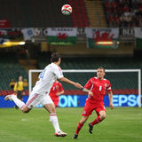 Football Soccer Player. Sergei Ignashevich (left) of Russia and Craig Bellamy (right) of Wales fights for the ball during their 2010 World Cup Qualifiying match stock photo