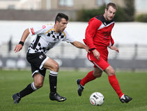 Football Soccer Player. Carlos Castan (left) of Neath Athletic and Osian Jones (right) of Bala Town race for the ball during their Welsh Premier League match Stock Photography