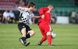 Football Soccer Player. Ricky Evans (rigth) of Bala Town protects the ball from Matthew Harris (left) of Neath Athletic during their Welsh Premier League match Stock Photos