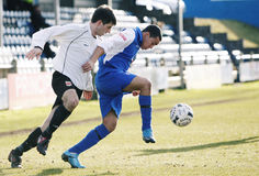 Football Soccer Player. PORT TALBOT, WALES - FEBRUARY 20: Drew Fahiya (right) of Port Talbot and Martyn Beattie (left) of Welshpool in action during their Welsh Stock Image
