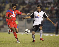 Football Soccer Player. TERENGGANU - JANUARY 30: Terengganu Ashaari Shamsuddin (right) and Kuala Lumpur Jeremy Denker (left) fights for the ball during their stock images