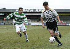 Football Soccer Player. NEATH, WALES - MARCH 13: Chris Llewellyn (right) of Neath controls the ball during their Welsh Premier League match against The New Royalty Free Stock Photography