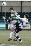 Football Soccer Player. NEATH, WALES - MARCH 13: Ian Hillier (right) of Neath and Alex Darlington (left) of The New Saints fights for the ball in play during Stock Image