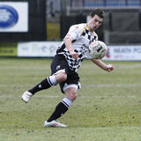 Football Soccer Player. NEATH, WALES - MARCH 13: Chris Jones of Neath in action during their Welsh Premier League match against The New Saints at The Gnoll Royalty Free Stock Photos