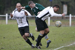 Football Soccer Player. Players of Pontypridd Town (white) and Ely Rangers (green) fights for the ball during their Welsh Football League 2 match at Ynysangharad Royalty Free Stock Photo