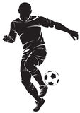Football (soccer) player with ball Royalty Free Stock Photo
