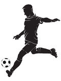 Football (soccer) player with ball Royalty Free Stock Image