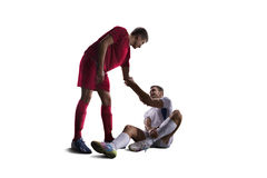 Football soccer player help another one isolated background Stock Photography