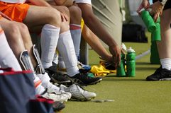 Football soccer players. Detail of Football soccer players legs while sitting on the bench Royalty Free Stock Image