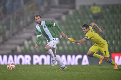 Football or soccer players in action during torrential rain Royalty Free Stock Images