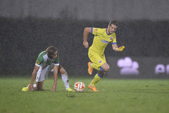Football or soccer players in action during torrential rain Royalty Free Stock Photos