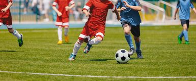 Football Soccer Players Running with Ball. Footballers Kicking Football Match royalty free stock images