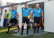 Football or soccer referees. Football referees pictured entering the field before the Romanian League 1 game between Sportul Studentesc and CFR Cluj held on Stock Images