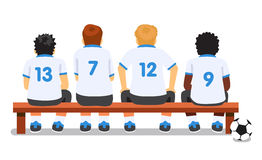 Football soccer sport team sitting on a bench Royalty Free Stock Images