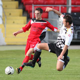 Football Soccer Tackle. Marc Griffiths (left) of Bala Town is being challenged by Rory Smitham (right) of Neath Athletic during their Welsh Premier League match stock image