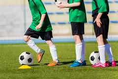 Football soccer training for children. Young boys preparing to the final game of soccer tournament Royalty Free Stock Photos