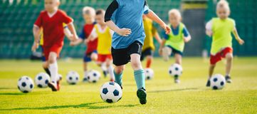 Football soccer training for kids. Young boys improving soccer skills Children football training