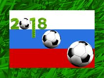 Football world cup 2018 background. Football Soccer World Cup 2018 with Russian Flag Balls and Decorated Date Over Green Grass Background Royalty Free Stock Photo