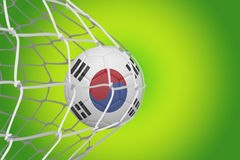 Football in south korea colours  at back of net Royalty Free Stock Photography