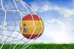 Football in spain colours at back of net Royalty Free Stock Photography