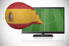 Football in spain colours flying out of tv Stock Images