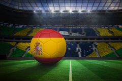 Football in spain colours. In large football stadium with brasilian fans stock illustration