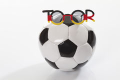 Football with spectacles on white background Stock Photos
