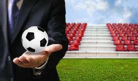 Football sport business concept. Ball in hand Royalty Free Stock Photos