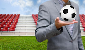 Football sport business concept. Ball in hand Royalty Free Stock Photography