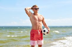 Young man with soccer ball on beach. Football, sport, fitness and people concept - young man with soccer ball on summer beach Royalty Free Stock Images