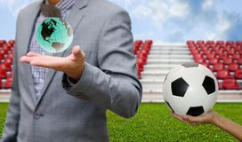 Football sport supporter concept, Ball in hand and world in hand. Football sport business concept, Ball in hand and world in hand Stock Photos